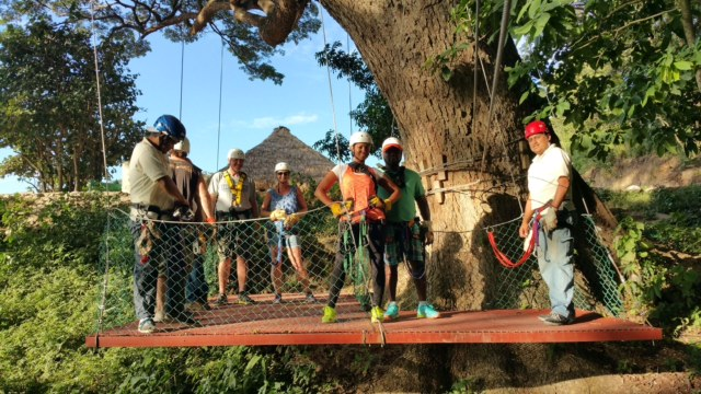 Staff and participants ziplining
