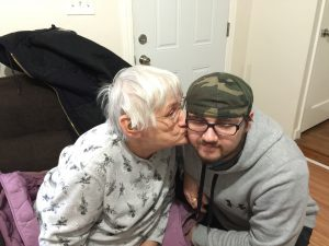 Participant getting a visit from his grandmother at his home